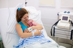 Young mother giving birth to a baby Stock Images
