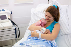 Young mother giving birth to a baby Royalty Free Stock Photos