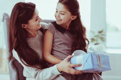 Young mother giving a present for her daughter stock photography