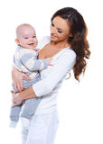 Young mother with a happy baby Royalty Free Stock Images