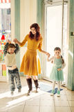 Young mother with happy children in the candy store Royalty Free Stock Photo