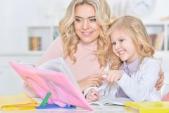 Mother and daughter doing homework Stock Photo