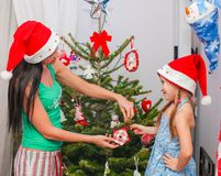 Young mother and her adorable little girl in Santa Royalty Free Stock Images