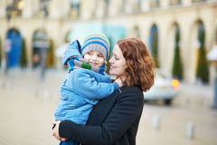 Young mother and her adorable little son walking together in Paris Stock Image