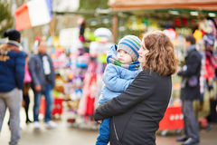 Young mother and her adorable little son walking together in Paris Stock Photo