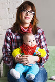 Young mother with her baby Royalty Free Stock Photos