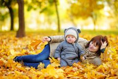 Young mother with her baby in autumn Stock Image
