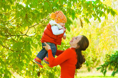 Young mother with her baby in autumn Royalty Free Stock Images