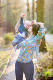 Young mother with her baby boy in forest Royalty Free Stock Photography