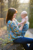 Young mother with her baby boy in forest Royalty Free Stock Image