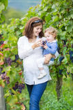 Young mother and her baby daughter in vine yard Stock Image