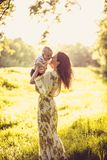 Young mother and her baby enjoy in nature at spring season. Family time royalty free stock photos