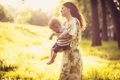 Young mother and her baby enjoy in nature at spring season. Family time royalty free stock image