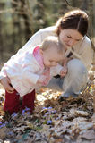 Young mother and her baby in a forest Royalty Free Stock Photography