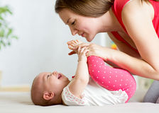 Young mother with her baby having fun pastime Royalty Free Stock Image