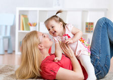 Young mother with her baby having fun pastime Stock Photo