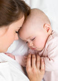 Young mother and her baby sleeping together Stock Photography
