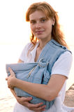 Young mother with her baby in sling Royalty Free Stock Photos
