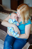 Young mother with her baby son in arms Royalty Free Stock Photo