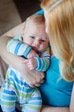 Young mother with her baby son in arms Stock Photo