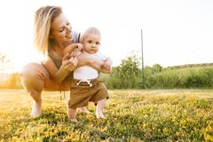 Young mother with her baby son. royalty free stock images