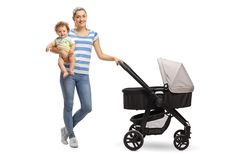 Young mother with her baby and a stroller Stock Photos