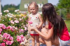 Young mother with her beautiful daughter sniffing Royalty Free Stock Images
