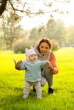 Young mother with her children in the park autumn Stock Photography