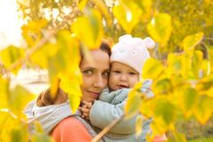 Young mother with her children in the park autumn Royalty Free Stock Photo