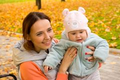 Young mother with her children in the park autumn Stock Images