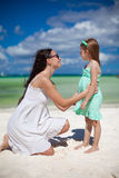 Young mother and her cute daughter have fun on Stock Photo