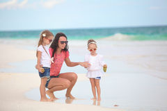 Young mother and her cute daughters enjoy summer Stock Images