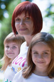 Young mother and her cute daughters outdoors Royalty Free Stock Photography
