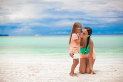 Young mother and her cute little girl whispering Royalty Free Stock Photos