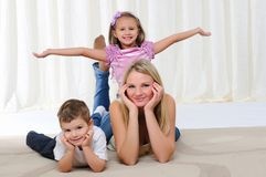 Young Mother, Her Daughter And Son Stock Photo