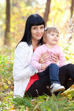 Young mother and her daughter on the autumv forest Royalty Free Stock Photos