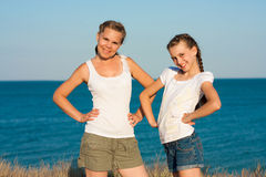 Young mother with her daughter on the beach. Stock Photography