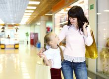 Young mother and her daughter doing shopping Stock Images