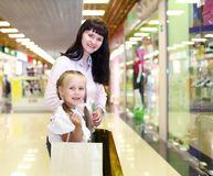 Young mother and her daughter doing shopping Royalty Free Stock Photo