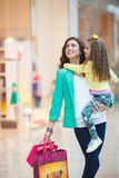 Young mother and her daughter doing shopping together Stock Photography