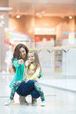 Young mother and her daughter doing shopping together Royalty Free Stock Photography