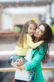 Young mother and her daughter doing shopping together Royalty Free Stock Image