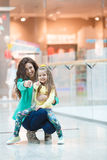 Young mother and her daughter doing shopping together Royalty Free Stock Images
