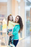 Young mother and her daughter doing shopping together Royalty Free Stock Photo