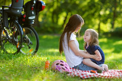 Young mother and her daughter having a picnic Royalty Free Stock Photography
