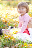 Young mother and her daughter lying on the autumn leav Royalty Free Stock Photography