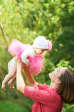 Happpy mother holding her baby Royalty Free Stock Images