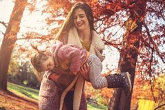 Sunny day in park. Mother and daughter. royalty free stock photos