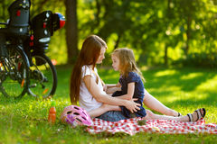 Young mother and her daughter picnicking Stock Image
