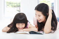 Young  mother and her daughter reading  book Royalty Free Stock Image